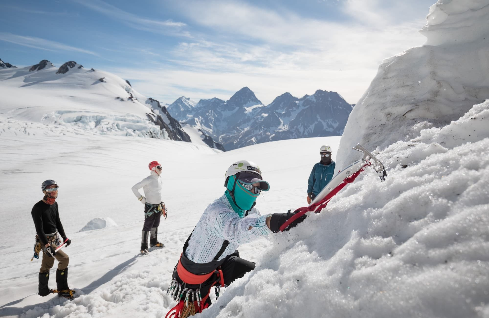 Woman ice climbing in NZ with group