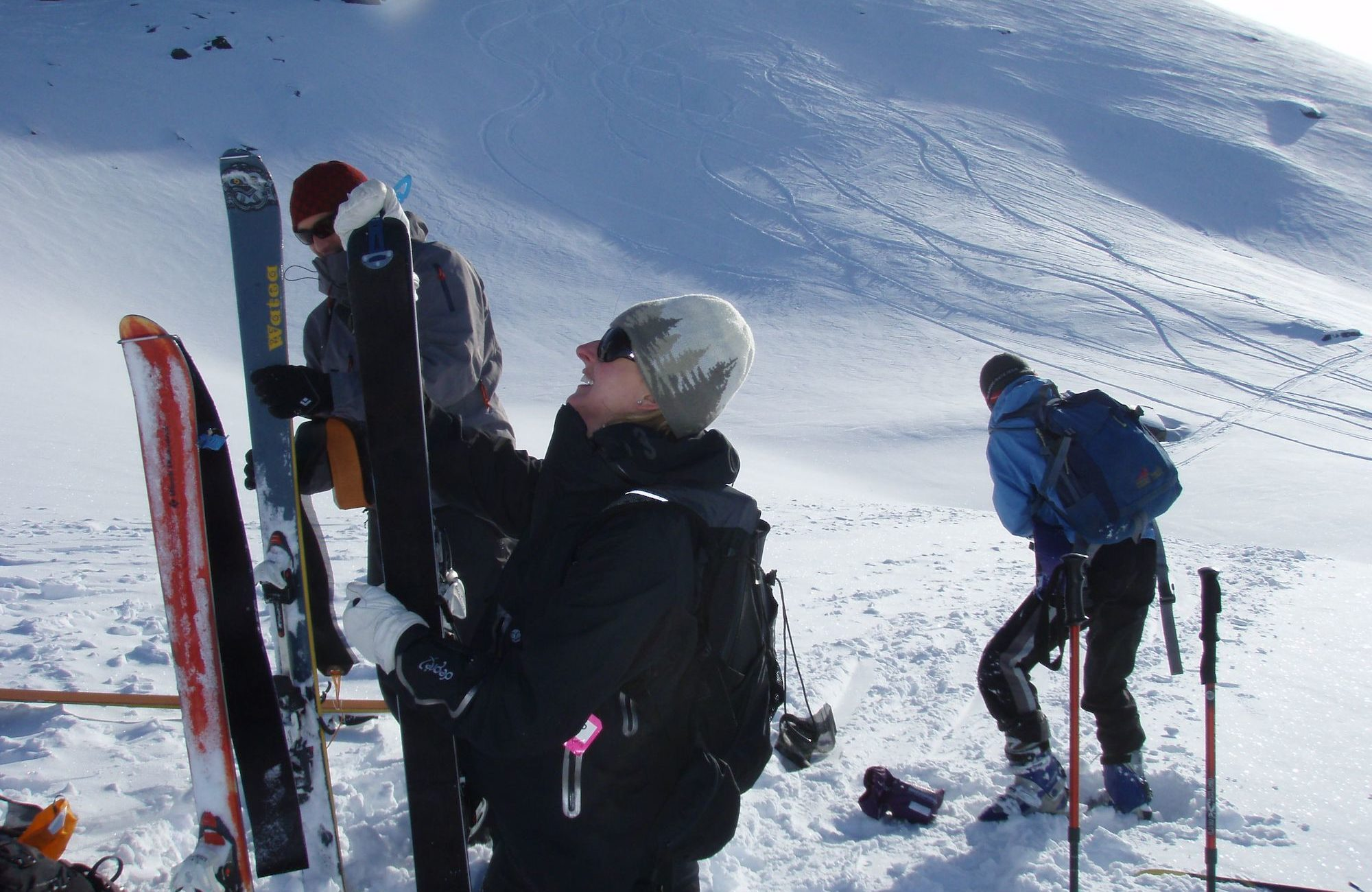 Peeling off skins for ski touring