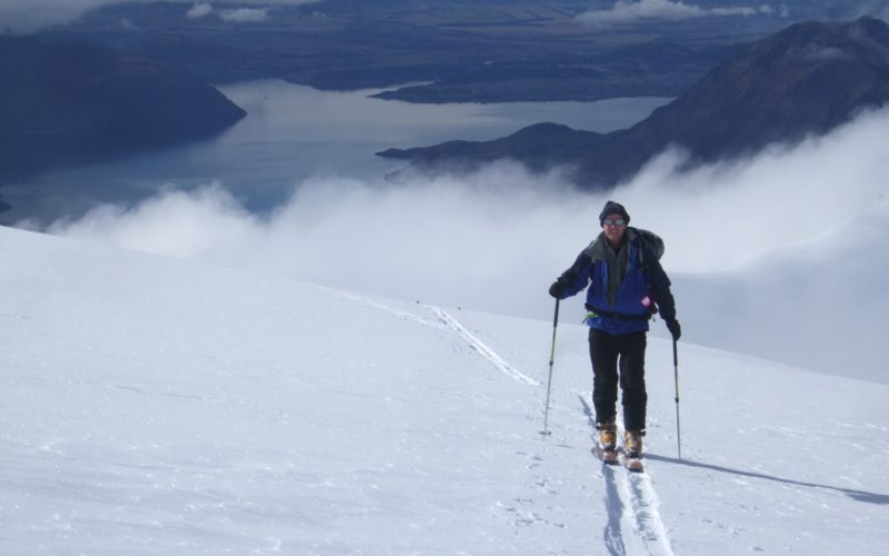 Ski touring with lake background